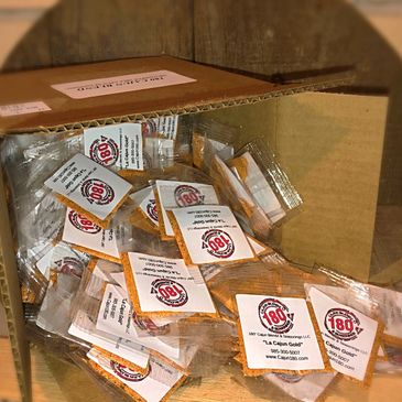 """La Cajun Gold"" Sample Packs.  Each pack contains approximately 5 grams of powdered seasoning."