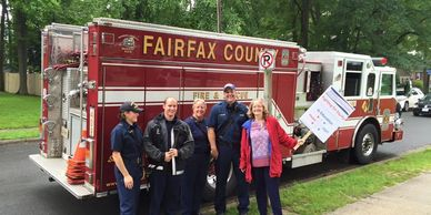 Karen with a few of our brave Firefighters on the 4th of July