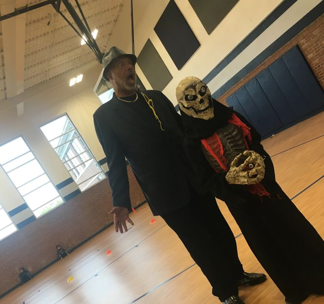 Mr. Parker is spooked by one of our members in a skeleton mask!