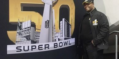 Dr. Joseph Bryant at the entrace of NFL Experience.  SUPERBOW 50 was held in San Francisco.