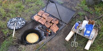 Dutch oven cornbread and pork ribs over the fire