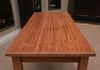 Solid Sapele w/Clear coat finish.