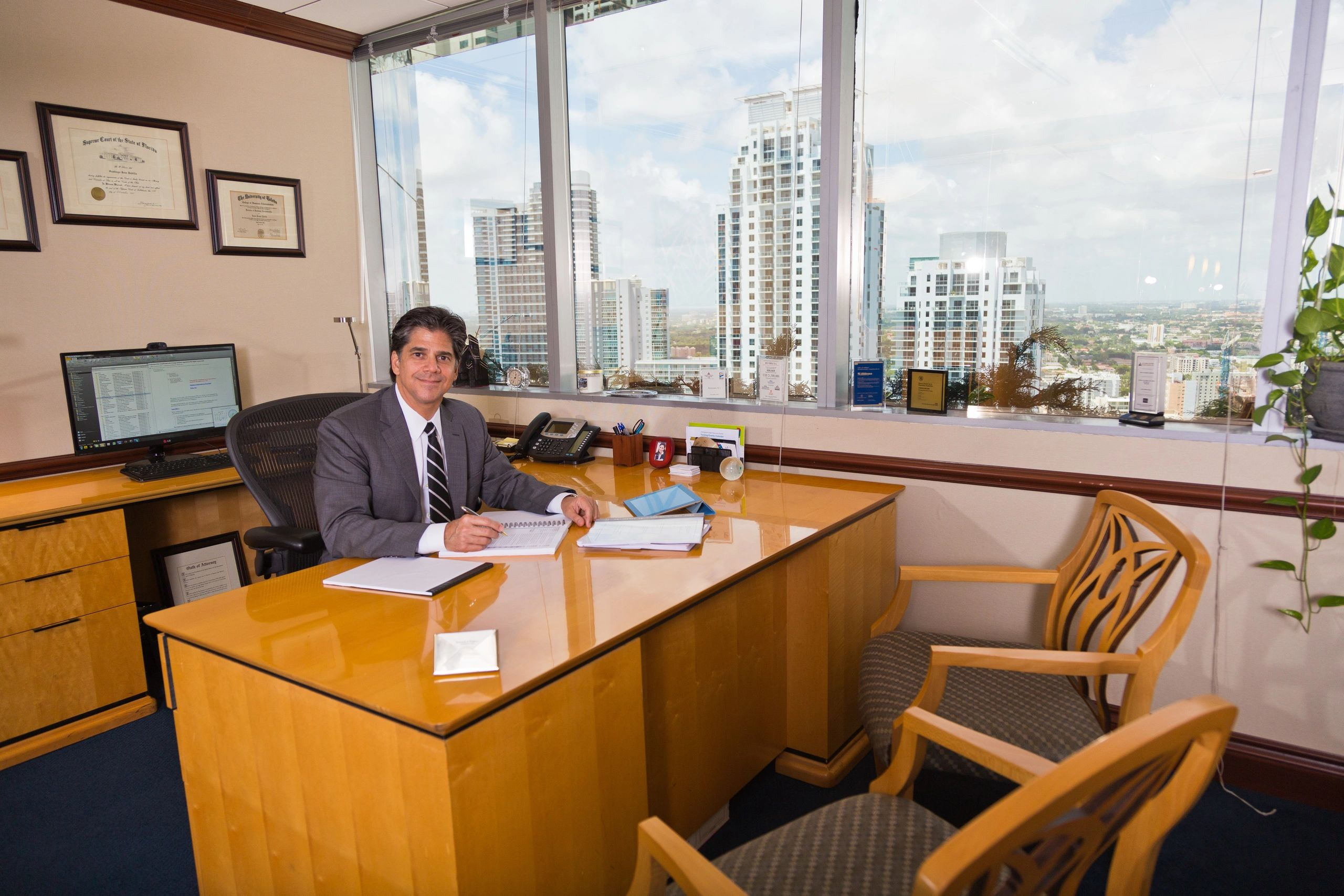 Santiago J. Padilla, Esq. sitting at his desk.