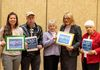 SAGE representatives, from left, Tai Bacani, Bob O'Neil, Cathy Gorman, The Rev. Donnie Anderson, and Marjorie Moskol