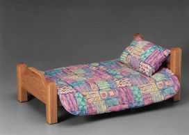 Includes removable fabric covered mattress, pillow and comforter.  Very sturdy.  $75.00