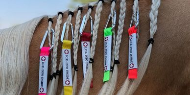 The I.C.E. UltraLite makes it possible to clip visible identification to your horse's braided mane.