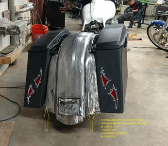 Custom rear fender and saddlebags with custom l.e.d. lights on the rear fender,frenched in license plate,also has stretched dash and stretched tanks covers on a 2014' Harley Davidson street glide