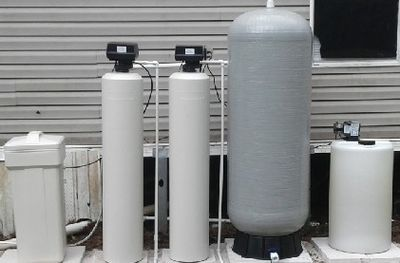 Well water treatment system retention tank chlorine pump  flow switch carbon filter water softener