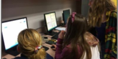 HTML coding workshop in the CREATESpace during the Girls Do event in June 2019