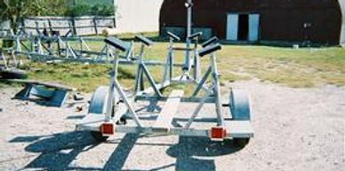 J 22 and J 24 trailer fits most any boat with a deep draft.The axles are on slides U-bolted to frame