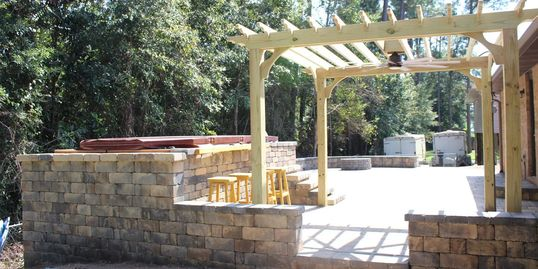 outdoor living space, retaining wall, sitting wall, pergola, custom work, pavers, wall block