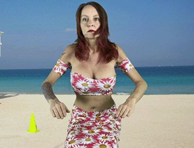 Redheaded big tits Fembot on the beach