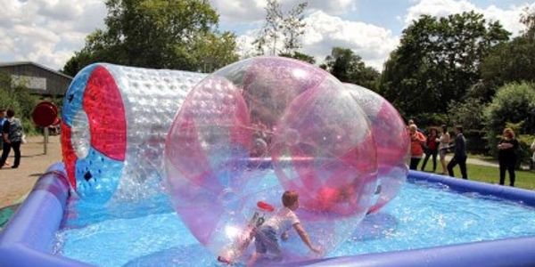 Zorb balls, pools, water wheels, summer fun party ideas in the IE OC LA. Water summer party in OC