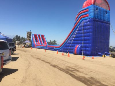 The largest inflatable mobile zip line that is portable & huge inflatable Titanic Slide in So Cal.