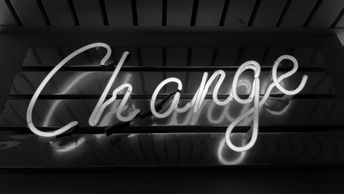 Neon sign showing the word 'Change'