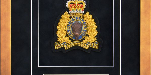 RCMP transfer display.  RCMP crest and sublimated plate