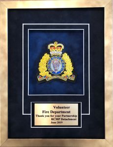 RCMP transfer display.  RCMP crest on a navy blue background and sublimated plate