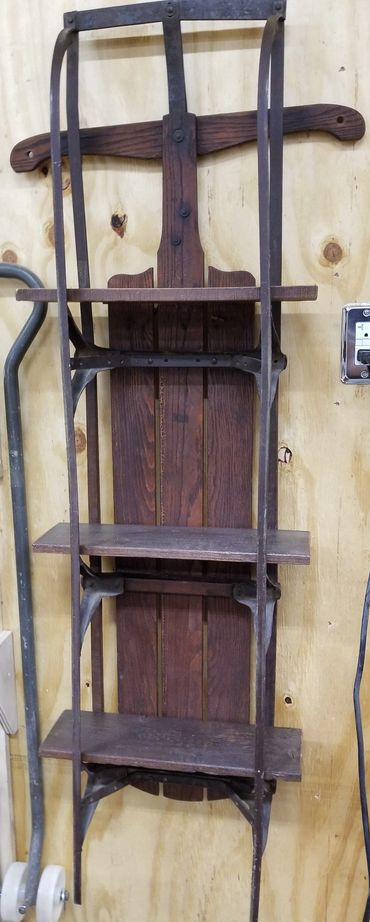 Old wooden sled turned into a hanging shelf