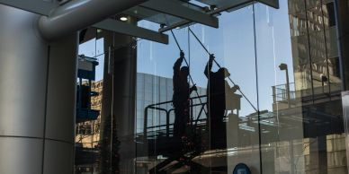 Cleaning windows on lift