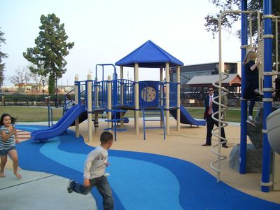 Central Park at Mill Creek play area showing surfacing & river inlay.