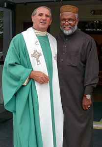 Fr. Gerry with a friend in traditional African cultural clothing.
