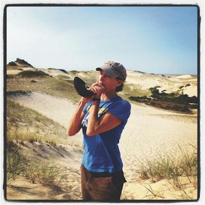 Zoë Lewis blowing her shofar in the Provincetown dunes, 2012
