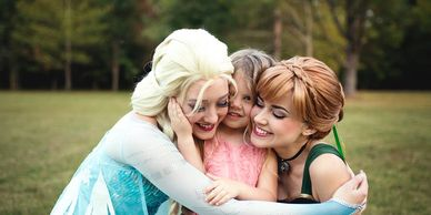 The Snow Sister Princesses in Nashville give warm hugs. This birthday party isn't going to be frozen