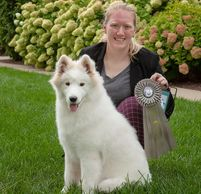 Breeder/Owner Katie Heidt shows off Tesser's Sweepstakes ribbon!