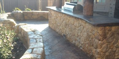Here is a custom outdoor kitchen with concrete trees and fire pit.  Much, much more!