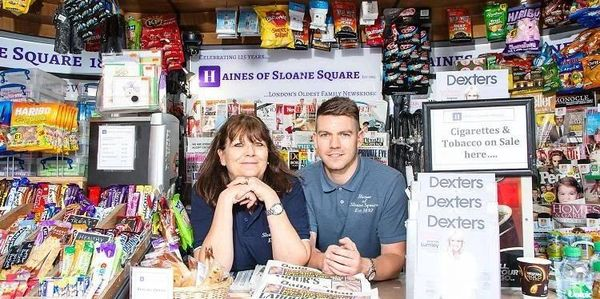 Owners of Haines of Sloane Square showing their products