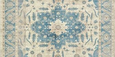 decorative area rug with blue motif offered by The Design Gallery and our vendor Jaunty Area Rugs