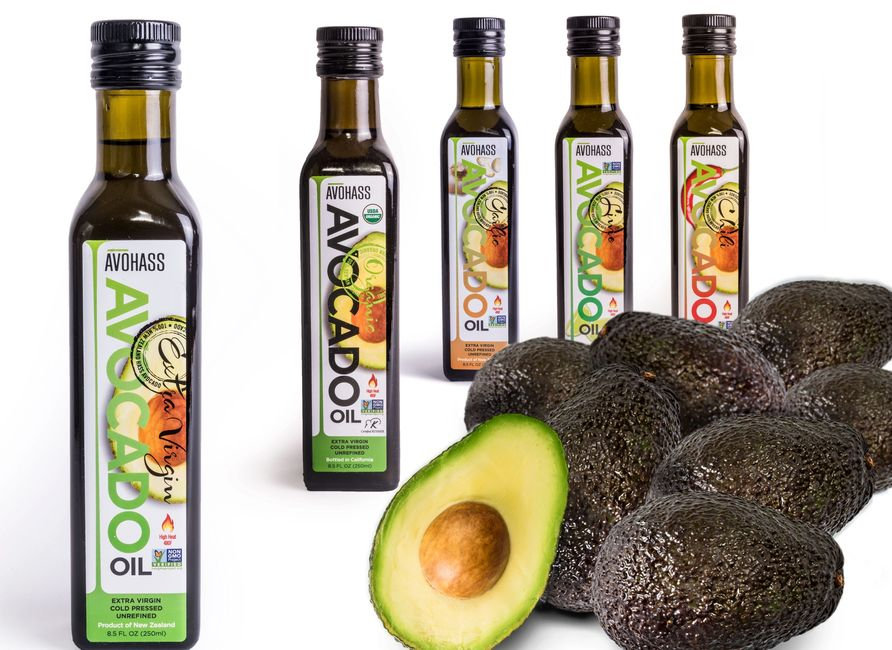 avohass single bottle display with avocados in foreground