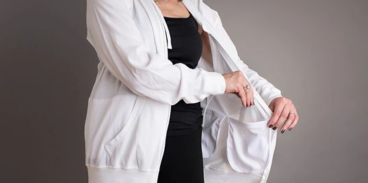 Jacket with Internal pockets to hold and conceal surgical drains used at post operative surgery.