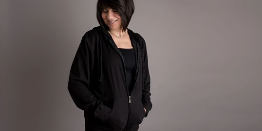 Jacket/shirt to hold and conceal surgical drains after mastectomy surgery or other surgeries.