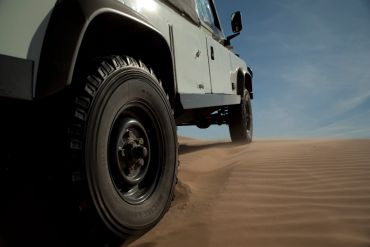 expedition exchange michelin xzl 8.25 r16 jack quinlan land rover defender 110 soft top altar desert