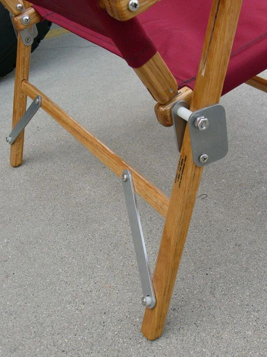 Burgundy Kermit Chair constructed of white oak aluminum stainless steel 350 lbs. weight rating