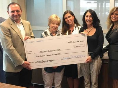 Donating $100k to Memorial Hospital in my capacity as Board Member of Charitable Foundation.