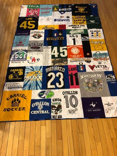 T-Shirt quilt collage. Twin bed size for a dorm bed.