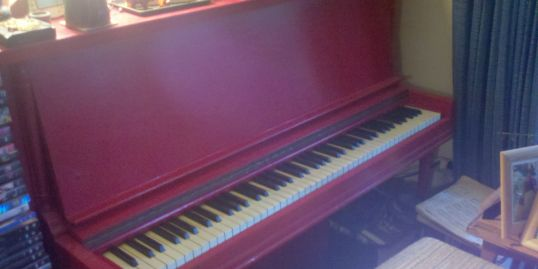 The piano on which I first learned to play.