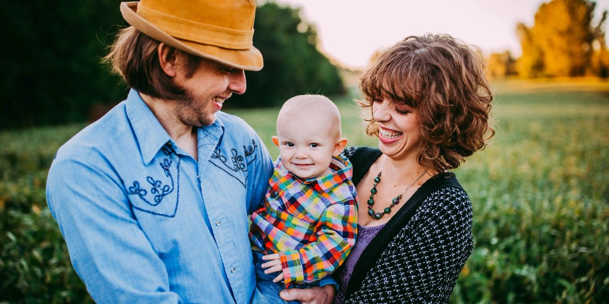 Image of Artist Laurie Sewell-Muller with her husband Jay, and son, Arlo.