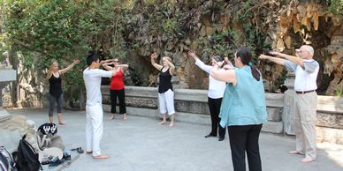 Spiritual Retreat Guests practicing Tai Chi on top of Marble Mountain, Da Nang, Vietnam
