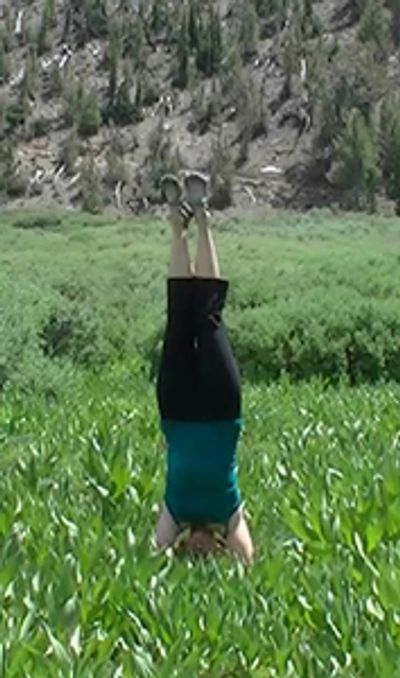 Samantha of Yoga Desires in Headstand pose at Mt. Rose trail, Desolation Wilderness, Lake Tahoe, Nevada