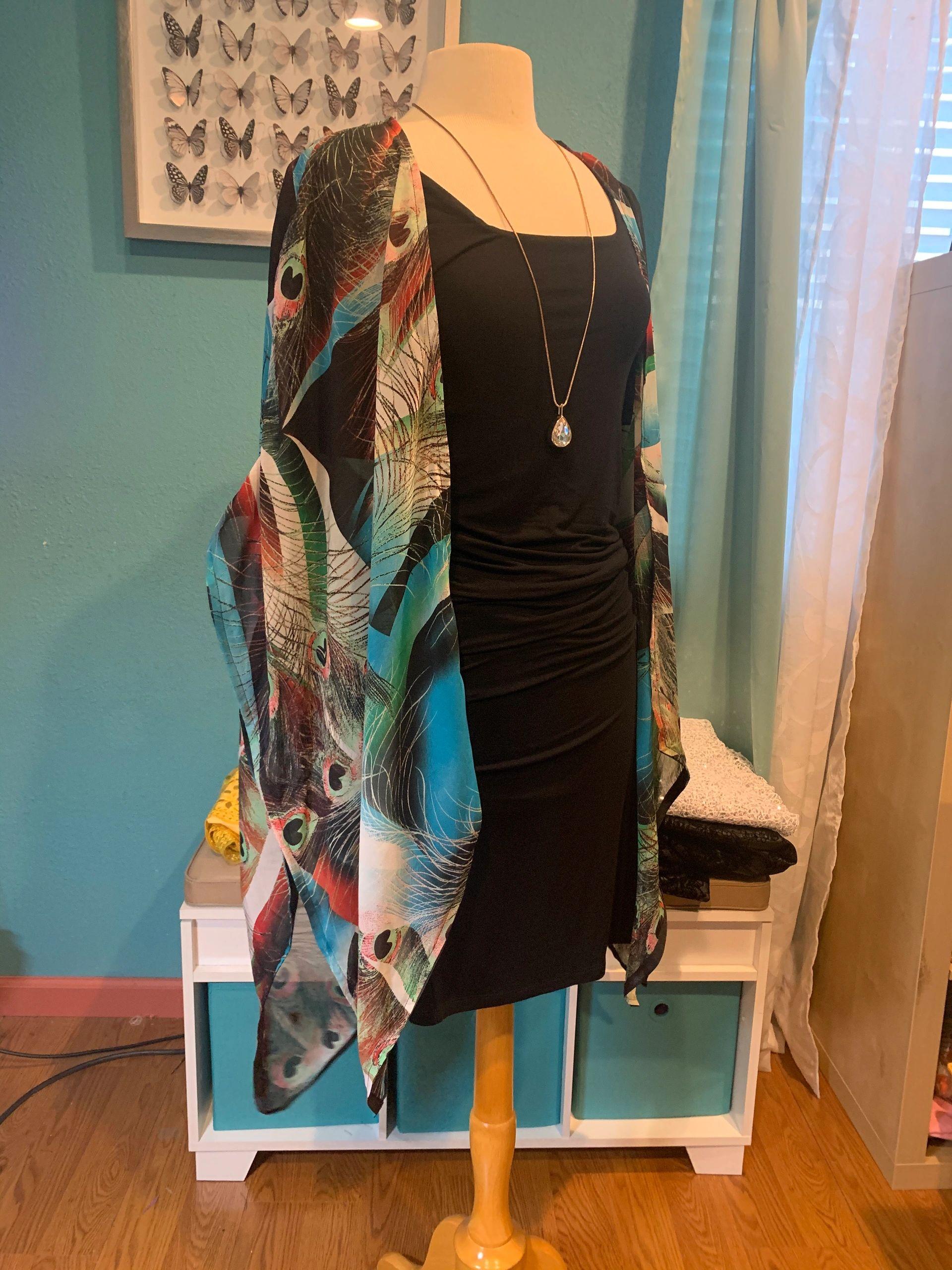 Peacock print kimono wrap. $75 Plus shipping and handling.