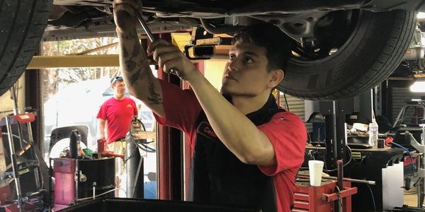 Cesar Regalado changing oil Don Brown Automotive & Transmission