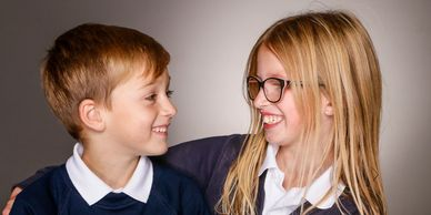 School photograph with brother and sister. School Photography offering Free Family Photographs.
