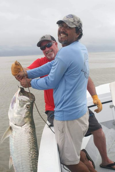 Aaron and Primo of our sport fishing team doing what they love most - pulling in a 100# Tarpon!