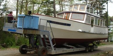 Carpentry, paint, and fiberglass on a G. Guptill 44