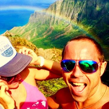 colorful sunglasses in hawaii with a rainbow