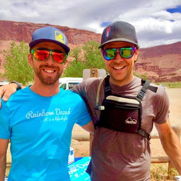 colorful sunglasses on athlete standup paddle board guys at back of beyond sup race in moab utah