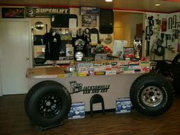 Image of Jacksonville 4x4 showroom with car and truck accessories, step bar, U bolts, shocks.